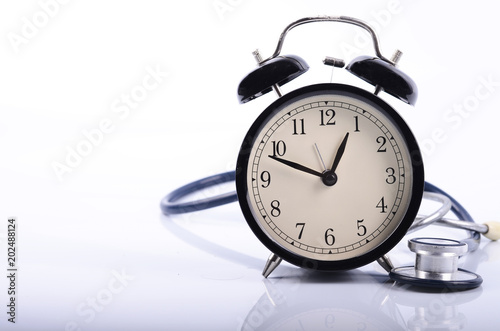 stethoscope and vintage clock face simulating medical appointment