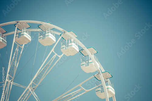 Ferris wheel municipal park with blue clear sky on the background