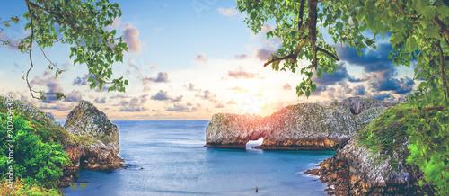 Fotobehang Blauwe hemel Impresionante e idilico paisaje de playa y mar en Cantabria.Acantilados y montañas.Puesta de sol y naturaleza salvaje