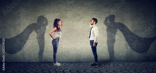 Leinwanddruck Bild Brave man and woman posing as super hero