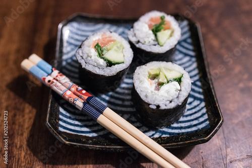 Fotobehang Sushi bar sushi plate with cute chopsticks
