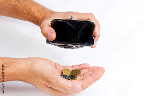 Man holding an empty wallet over an empty hand . The concept of poverty. Bankruptcy