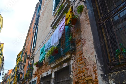 Fototapeta street, architecture, city, building, house, italy, europe, town, narrow, travel, venice, alley, ancient, urban, buildings, spain, france, wall, exterior, italian, sky, village, mediterranean, stone,