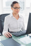 Focused businesswoman working on her computer - 202534374