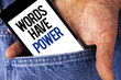 Writing note showing  Words Have Power. Business photo showcasing Statements you say have the capacity to change your reality written on Mobile phone screen holding by man on the Jeans background.