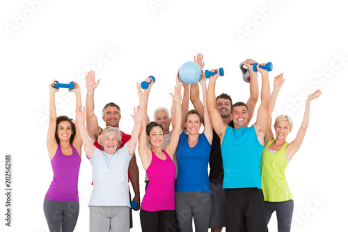 Cheerful people holding exercise equipment