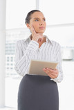 Confused businesswoman using a tablet pc - 202562971