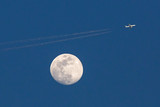 Airliner and Full Moon