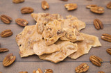 Homemade Pecan Brittle on a Wooden Table - 202576599