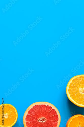 Citrus fruits top view border background.