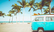 Leinwandbild Motiv vintage car parked on the tropical beach (seaside) with a surfboard on the roof - Leisure trip in the summer. retro color effect