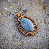 Natural gemstone necklace on stone background