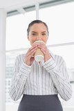 Peaceful businesswoman drinking coffee - 202616398