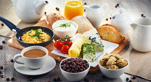 Breakfast served with coffee, cheese, cereals and scrambled eggs