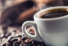 "Постер, картина, фотообои ""Cup of black coffee with beans on wooden table"""
