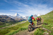 Leinwandbild Motiv Mit dem Mountainbike vorbei am Matterhorn in den Schweizer Alpen, Kanton Wallis, Schweiz