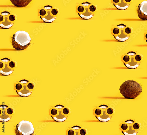 Series of coconuts wearing sunglasses on a yellow background - 202665712