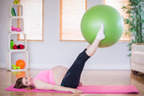 Pregnant woman doing exercise with exercise ball  - 202667150