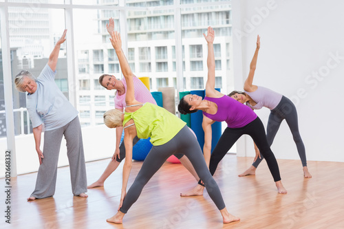 Plexiglas Fitness Women doing stretching exercise in gym