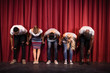 Actors bowing on the stage