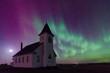 Aurora Borealis over the historical St. John's Lutheran Church established in 1919 near Cabri, Saskatchewan, Canada