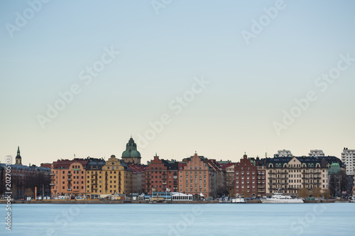 Plexiglas Stockholm Beautiful scenic panorama of the Old City (Gamla Stan) cityscape pier architecture with historic town houses with colored facade in Stockholm, Sweden. Creative long time exposure landscape photography
