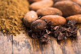 cacao beans and cacao powder in spoon - 202713705