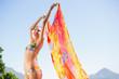 Quadro Beautiful brunette in bikini holding sarong up