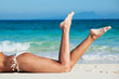 Leinwanddruck Bild - Tanned woman in bikini