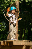 boy at climbing activity in high wire forest park - 202734990