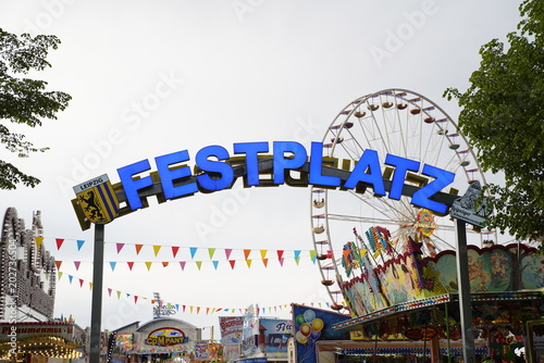 Fotobehang Las Vegas Amusement park (Festplatz) sign at the entrance with carousels in the background in Leipzig, Germany (Kleinmesse)