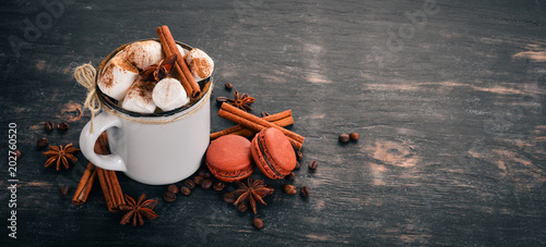 Canvas Chocolade Cappuccino with cinnamon and marshmallow. Top view On a wooden background, Copy space.