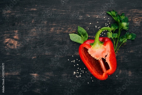 Fresh Bulgarian pepper. Paprika. On a wooden background. Top view. Copy space. - 202760571