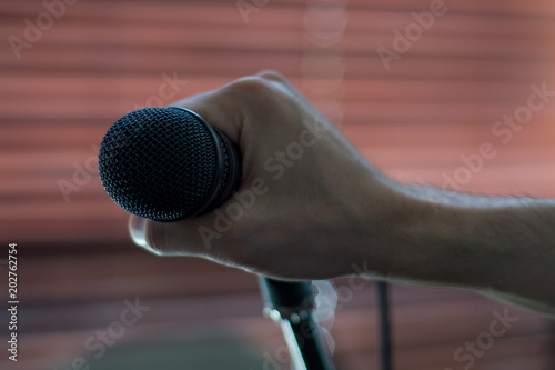 Fototapeta Microphone ready on stand, all set for concert to begin