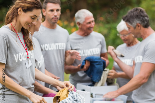 Happy volunteer looking at donation box © WavebreakmediaMicro