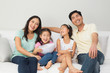 Quadro Happy family of four watching tv in living room