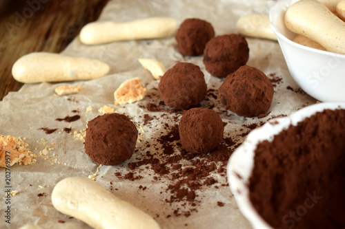 Fototapeta Chocolate truffles sprinkled with cocoa powder and meringues
