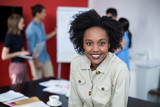 Portrait of smiling business executive at meeting - 202771544