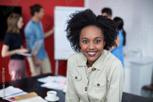 Portrait of smiling business executive at meeting