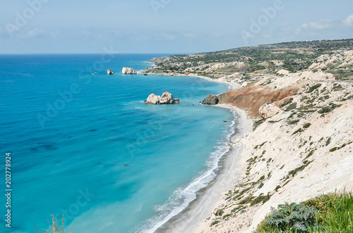 Plexiglas Cyprus Sea and mountains landscape view. Light blue water and white rocks. Cyprus, Mediterranean Sea. Aphrodite beach. Summer, travel, vacation concept. Copyplace, place for text