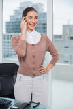 Cheerful classy businesswoman on the phone - 202784574