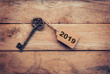 Business concept old key vintage with tag for New Year Resolution 2019. - 202786145