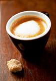 Cup od Espresso Macchiato and brown sugar cube - 202787188