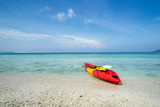 Colorful kayak on the tropical beach with blue sky