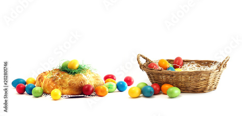 basket with easter eggs with challah yeast pastries bread plait isolated
