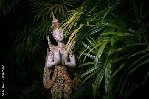 Plexiglas Boeddha close up view of thai style statue on green back