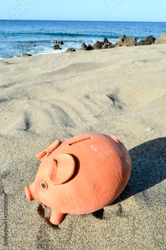 Piggy Bank on the Sand Beach - 202816394