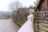 wedding photo session of the bride in the nature - 202816736