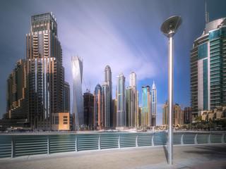 Day view of Dubai Marina bay with cloudy sky, UAE