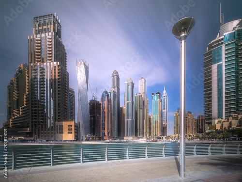 Day view of Dubai Marina bay with cloudy sky, UAE